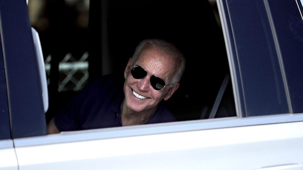 DES MOINES, IOWA - AUGUST 08: Democratic presidential candidate and former Vice President Joe Biden rolls down the window of his truck to say goodbye to supporters as he leaves the Iowa State Fair August 08, 2019 in Des Moines, Iowa. 22 of the 23 politicians seeking the Democratic Party presidential nomination will be visiting the fair this week, six months ahead of the all-important Iowa caucuses.