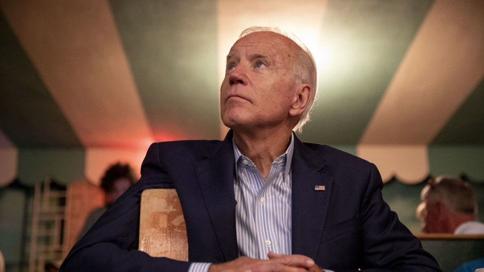 Former U.S. Vice President Joe Biden, 2020 Democratic presidential candidate, listens during a video presentation at the Democratic Wing Ding event in Clear Lake, Iowa, U.S., on Friday, Aug. 9, 2019.