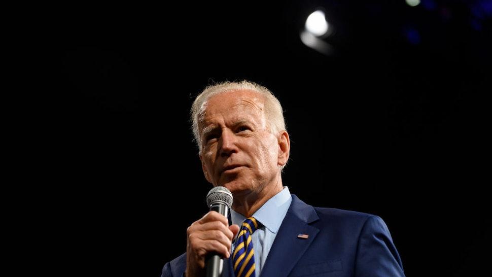 Joe Biden speaks on stage during a forum on gun safety at the Iowa Events Center