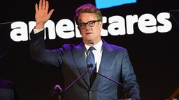 ARMONK, NY - OCTOBER 14: Co-host Joe Scarborough speaks onstage during the 2017 Americares Airlift Benefit at Westchester County Airport on October 14, 2017 in Armonk, New York