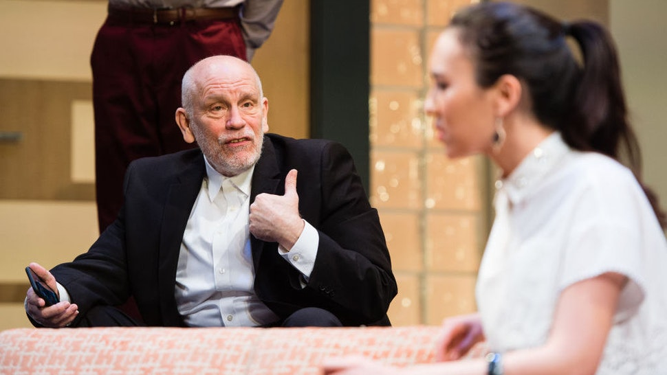 """John Malkovich and Ioanna Kimbrook during the """"Bitter Wheat"""" by David Mamet photocall on June 13, 2019 in London, United Kingdom."""