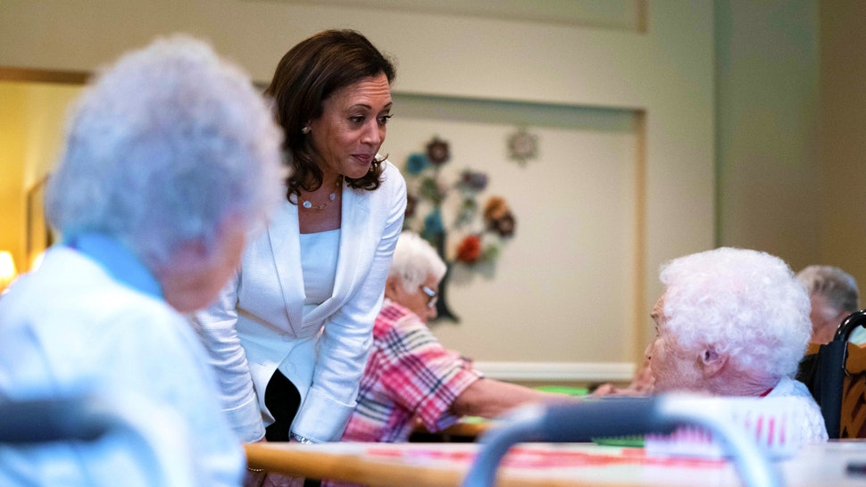 2020 Democratic Presidential hopeful Senator Kamala Harris (D-CA) greets residents and staff during a campaign stop at the Bickford Senior Living Center on August 12, 2019 in Muscatine, Iowa. - Harris finishes a multi-day bus tour across Iowa today. (Photo by Alex Edelman / AFP)