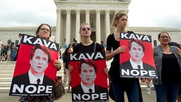 Protesters against US Supreme Court nominee Brett Kavanaugh demonstrate at the US Supreme Court in Washington, DC, on October 6, 2018.