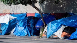 Tents line the street in Skid Row in Los Angeles, California on September 17, 2019.