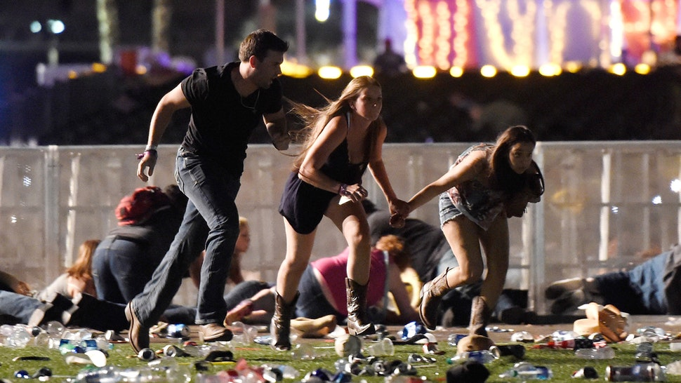 LAS VEGAS, NV - OCTOBER 01: People run from the Route 91 Harvest country music festival after apparent gun fire was hear on October 1, 2017 in Las Vegas, Nevada. A gunman has opened fire on a music festival in Las Vegas, leaving at least 20 people dead and more than 100 injured. Police have confirmed that one suspect has been shot. The investigation is ongoing.