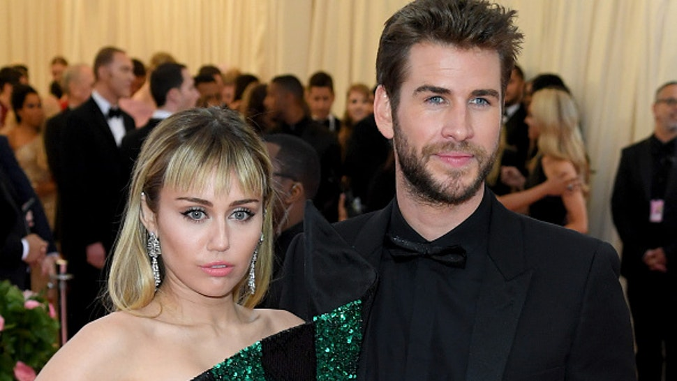 Miley Cyrus and Liam Hemsworth attend The 2019 Met Gala Celebrating Camp: Notes On Fashion at The Metropolitan Museum of Art on May 06, 2019 in New York City.