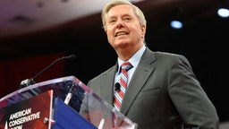 Lindsey Graham seen speaking during the American Conservative Union's Conservative Political Action Conference (CPAC)