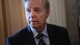 Lindsey Graham speaks to reporters as he arrives for a vote to overturn President Donald Trump's veto