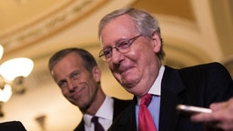 Mitch McConnell (R-KY) smiles after addressing reporters following a lunch with Senate Republicans.