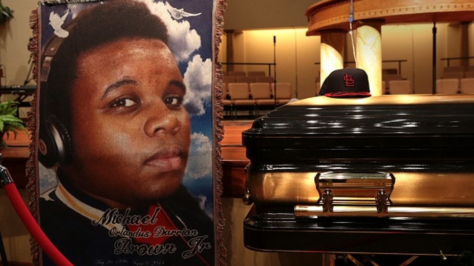 The casket of Michael Brown sits inside Friendly Temple Missionary Baptist Church awaiting the start of his funeral on August 25, 2014 in St. Louis Missouri.