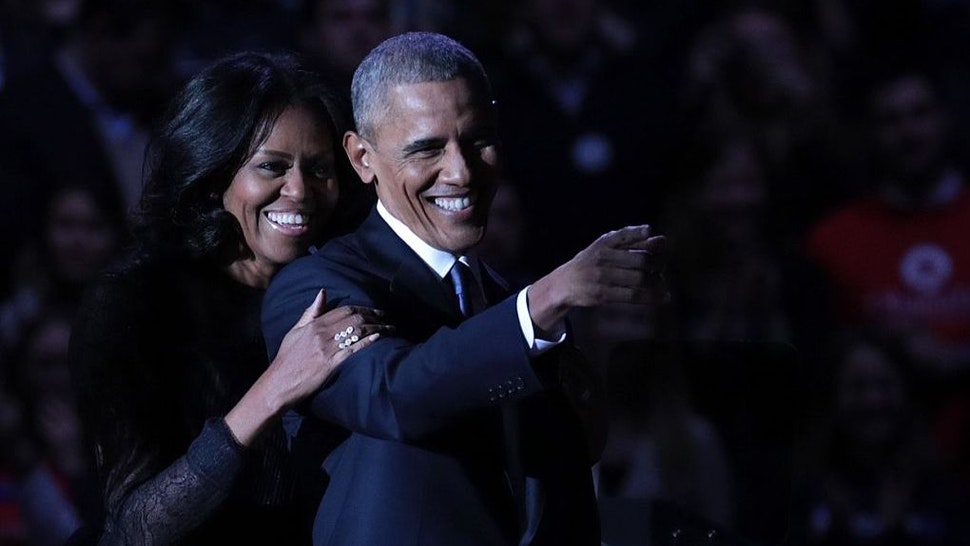 U.S. President Barack Obama greets daughter Malia (not seen) and first lady Michelle Obama on stage after delivering his farewell address at the McCormick Place, the largest convention center in North America, on January 10, 2017 in Chicago.