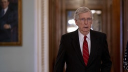 Senate Majority Leader Mitch McConnell walks toward his office after voting in the Senate Chamber