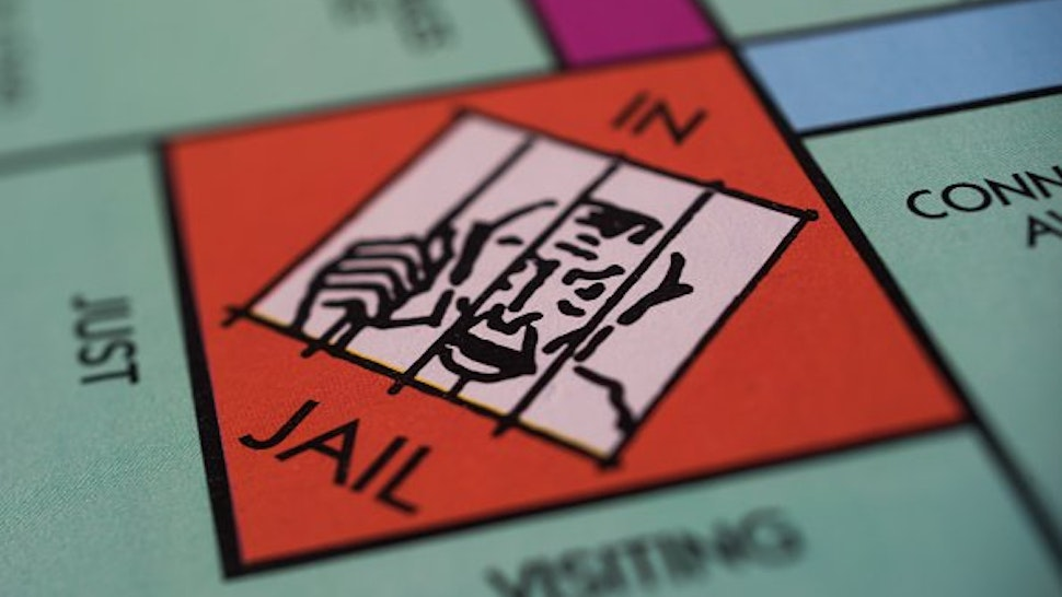 """The """"Jail"""" square is seen on a Hasbro Inc. Monopoly board game arranged for a photograph taken with a tilt-shift lens in Oradell, New Jersey, U.S., on Sunday, June 28, 2015."""