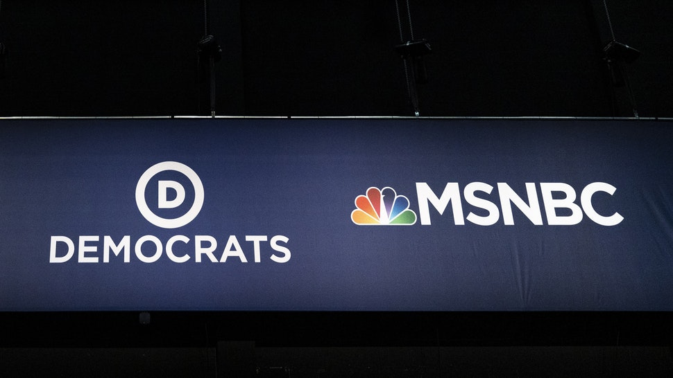 MIAMI, FL - JUNE 25: Advertising signage for NBC News and the Democratic Party is seen inside the media filing center at Adrienne Arsht Center for the Performing Arts where the first Democratic presidential primary debates for the 2020 elections will take place, June 25, 2019 in Miami, Florida.