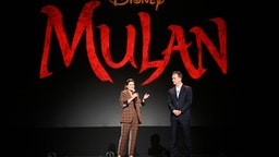 ANAHEIM, CALIFORNIA - AUGUST 24: (L-R) Director Niki Caro of 'Mulan' and President of Walt Disney Studios Motion Picture Production Sean Bailey took part today in the Walt Disney Studios presentation at Disney's D23 EXPO 2019 in Anaheim, Calif. 'Mulan' will be released in U.S. theaters on March 27, 2020.