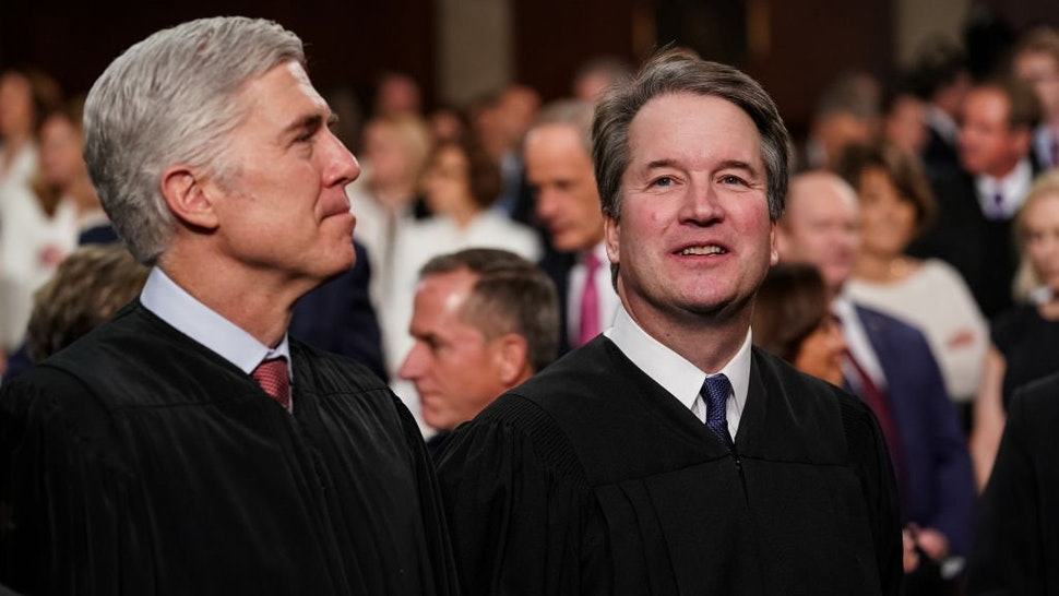 Supreme Court Justices Neil Gorsuch and Brett Kavanaugh attend the State of the Union address in the chamber of the U.S. House of Representatives at the U.S. Capitol Building on February 5, 2019 in Washington, DC.