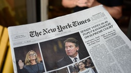 The headline on the front page of The New York Times declares that the United States Senate confirmed the nonination of Brent Kavanaugh to the U.S. Supreme Court.