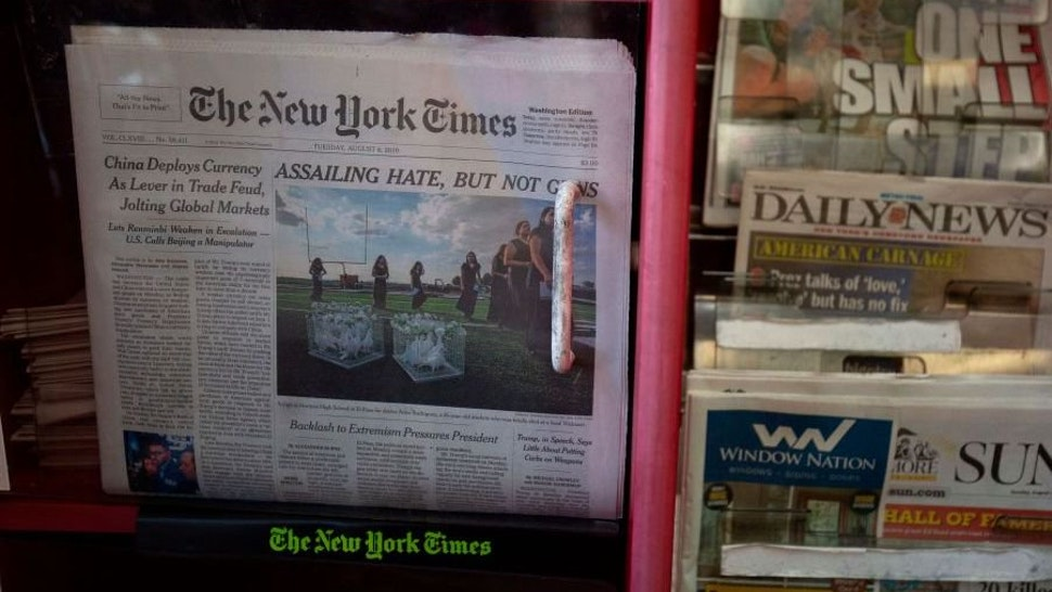 The front pages of The New York Times, New York Post, New York Daily News and Baltimore Sun newspapers are seen at a convenience store in Washington, DC, on August 6, 2019.