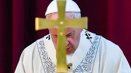 Pope Francis prays as he celebrates a mass for the Feast of Corpus Christi in the parish of Santa Maria Consolatrice in Romes Casal Bertone neighborhood on June 23, 2019.