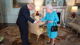 Queen Elizabeth II welcomes newly elected leader of the Conservative party, Boris Johnson during an audience where she invited him to become Prime Minister and form a new government in Buckingham Palace on July 24, 2019 in London, England.