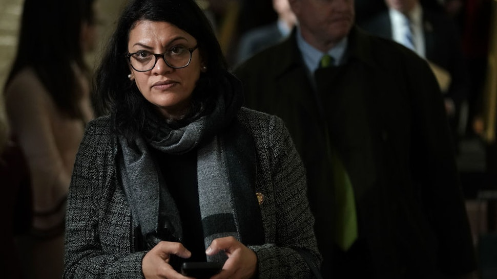 Rashida Tlaib leaves after a caucus meeting at the U.S. Capitol