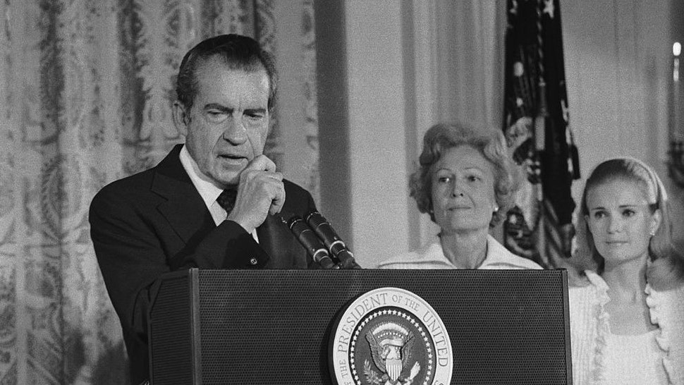 President Richard Nixon says an emotional farewell to his staff and cabinet in the East Room of the White House after resigning from office. His wife, Pat, and daughter Tricia are at right.