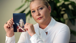Virginia Roberts holds a photo of herself at age 16, when she says Palm Beach multimillionaire Jeffrey Epstein began abusing her sexually.