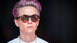 Megan Rapinoe #15 of Seattle Reign FC with pink hair and sunglasses stands in on the sideline due to an injury before the National Women's Soccer League match between Sky Blue F.C. and Seattle Reign F.C.. The match was held at Red Bull Arena on August 18,