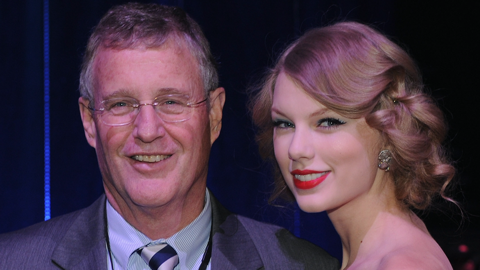 Scott Swift and Honoree/Daughter Taylor Swift at the 2011 CMT Artists of the year celebration at the Bridgestone Arena on November 29, 2011 in Nashville, Tennessee.