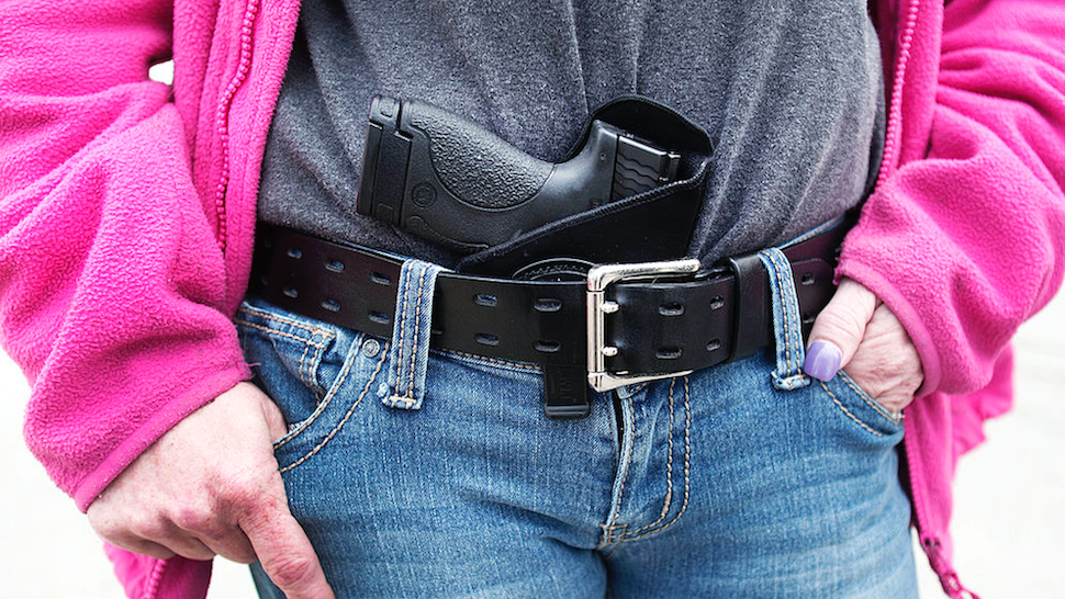 Gloria Lincoln-Thompson of Garden City, Michigan carries her Smith & Wesson Shield 9mm pistol in her belt while participating in a rally and march supporting Michigan's Open Carry law April 27, 2014 in Romulus, Michigan.