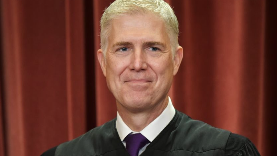Associate Justice Neil Gorsuch poses for the official group photo at the US Supreme Court in Washington, DC on November 30, 2018.