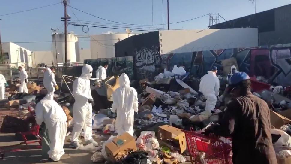 Activists help clean up trash-strewn Los Angeles.
