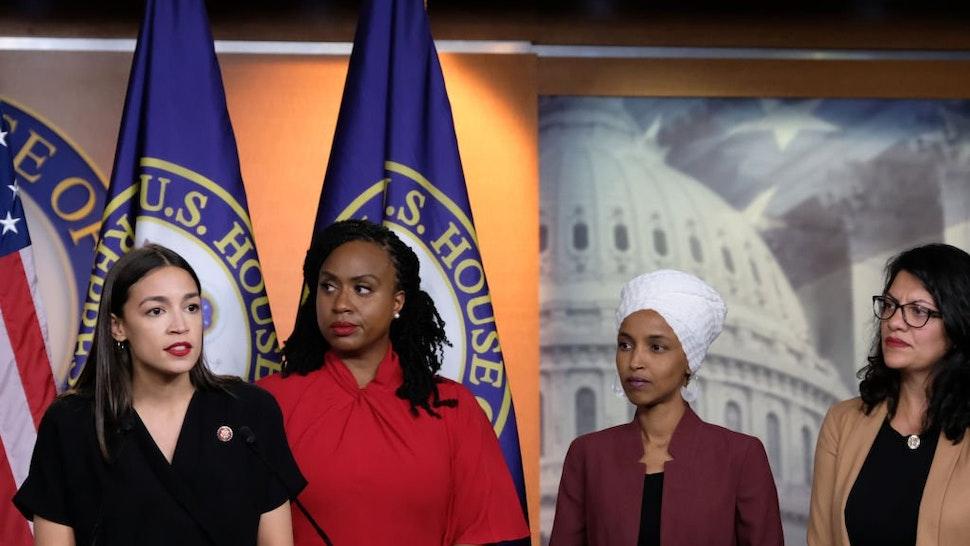 Rep. Alexandria Ocasio-Cortez speaks as Reps. Ayanna Pressley, Ilhan Omar and Rashida Tlaib listen during a news conference