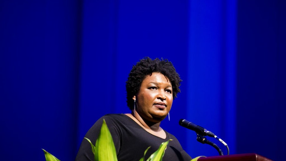Stacey Abrams pauses while speaking during the 110th NAACP Annual Convention in Detroit, Michigan