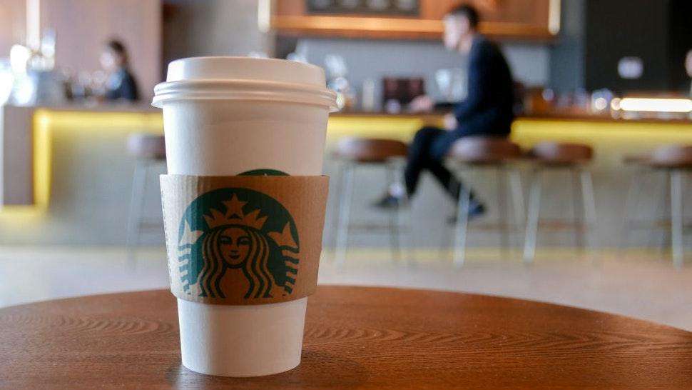 TIANJIN, CHINA - 2018/01/08: A coffee cup in a Starbucks coffee shop, arranged for photography. Since January 1st, Starbucks took back the management rights of more than 1300 stores in East China from the agent's hands, and has achieved 100% running and ownership in the mainland of China. The move is to speed up its expansion and development in China.
