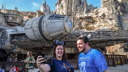 """Nycole Tylka, and her brother, Nate Tylka take selfies in front of the Millennium Falcon on opening day at Star Wars: Galaxy""""u2019s Edge at Disneyland in Anaheim, CA, on Friday, May 31, 2019"""