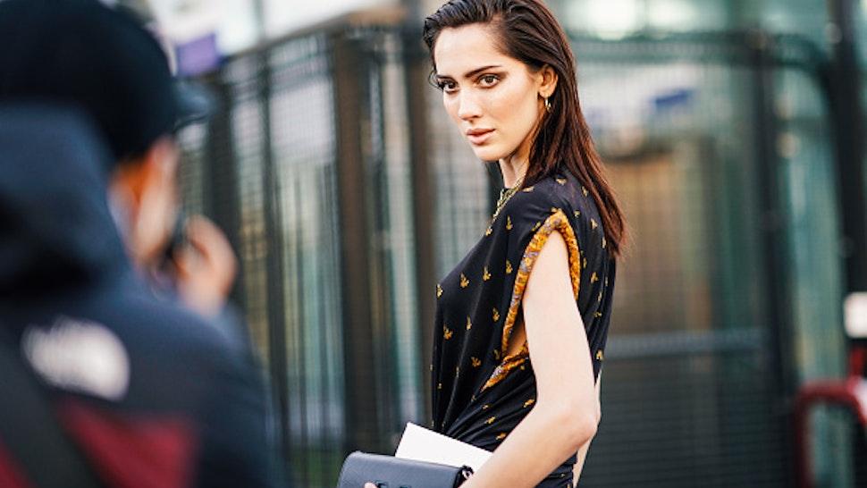 PARIS, FRANCE - FEBRUARY 28: Model Teddy Quinlivan wears a black and orange dress, a Vuitton bag, outside Chloe, during Paris Fashion Week Womenswear Fall/Winter 2019/2020, on February 28, 2019 in Paris, France.