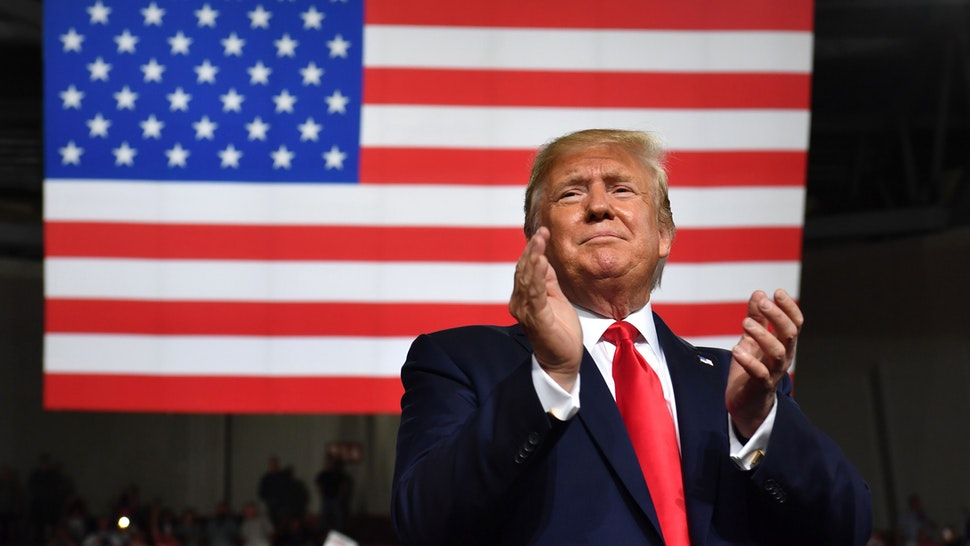 """US President Donald Trump speaks during a """"Keep America Great"""" campaign rally at the SNHU Arena in Manchester, New Hampshire, on August 15, 2019."""