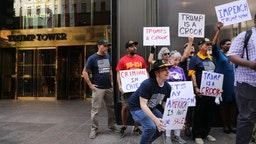 Members of a veterans group called Common Defense protest against President Donald Trump in front of Trump Tower on July 25, 2019 in New York City.