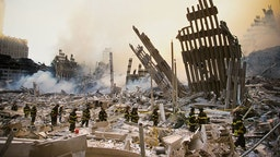 NEW YORK, NY - SEPTEMBER 12, 2001: The rubble of the World Trade Center smoulders following a terrorist attack 11 September 2001 in New York. A hijacked plane crashed into and destroyed the landmark structure.