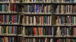 Shelves full of books on C-level, a quiet floor for studying, in the Milton S. Eisenhower Library on the Homewood campus of the Johns Hopkins University in Baltimore, Maryland, 2014.