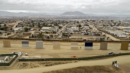 Prototype U.S.-Mexico border walls stand in this aerial photograph taken over San Diego, California, U.S., on Monday, Oct. 30, 2017.