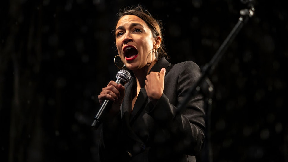 Alexandria Ocasio-Cortez speaks to the thousands of people who participated in the People Climate March