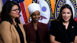 "U.S. Reps. Rashida Tlaib (D-MI), Ilhan Omar (D-MN) and Alexandria Ocasio-Cortez (D-NY) listen during a news conference at the U.S. Capitol on July 15, 2019 in Washington, DC. President Donald Trump stepped up his attacks on the four progressive Democratic congresswomen, saying that if they're not happy in the U.S. ""they can leave."""