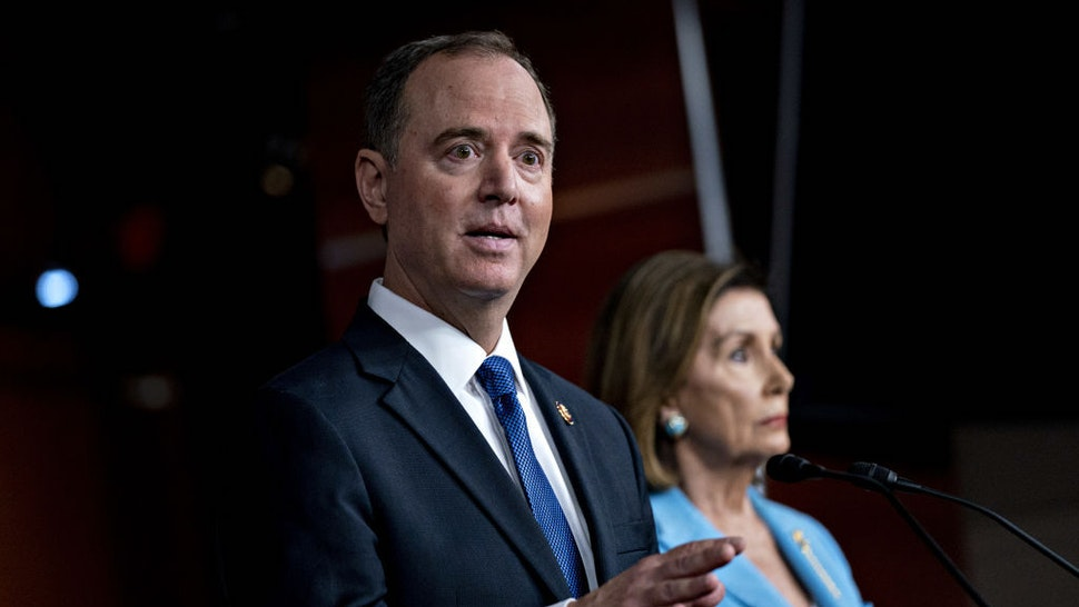 Representative Adam Schiff, a Democrat from California and chairman of the House Intelligence Committee, speaks as U.S. House Speaker Nancy Pelosi, a Democrat from California, right, listens during a news conference on Capitol Hill in Washington, D.C., U.S., on Wednesday, Oct. 2, 2019. Three House committee chairmen threatened on Wednesday to subpoena the White House if it fails to adhere by Friday to document requests related to allegations that President Donald Trump pressured Ukraine into investigating one of his leading political rivals. Photographer: Andrew Harrer/Bloomberg