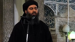 An image grab taken from a video released on July 5, 2014 by Al-Furqan Media shows alleged Islamic State of Iraq and the Levant (ISIL) leader Abu Bakr al-Baghdadi preaching during Friday prayer at a mosque in Mosul.(Photo by Al-Furqan Media/Anadolu Agency/Getty Images)