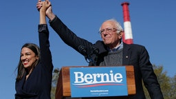 Rep. Alexandria Ocasio-Cortez (D-NY) endorses Democratic presidential candidate, Sen. Bernie Sanders (I-VT) at a campaign rally in Queensbridge Park on October 19, 2019 in the Queens borough of New York City. This is Sanders' first rally since he paused his campaign for the nomination due to health problems. (Photo by Kena Betancur/Getty Images)
