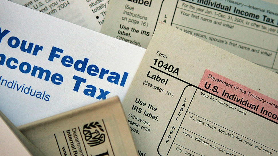 CHICAGO - NOVEMBER 1: Current federal tax forms are distributed at the offices of the Internal Revenue Service November 1, 2005 in Chicago, Illinois. A presidential panel today recommended a complete overhaul of virtually every tax law for individuals and businesses.