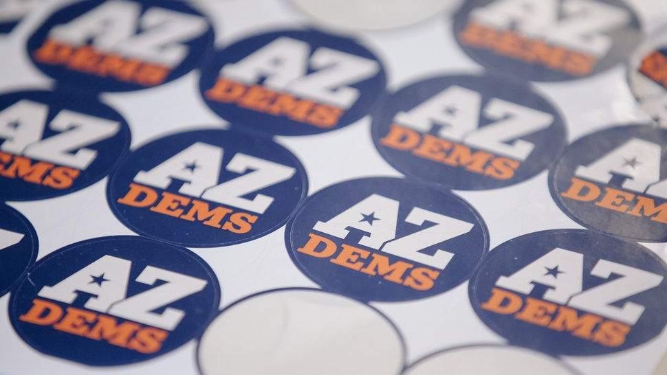 Stickers for the Arizona Democratic Party are displayed during a campaign event for Krysten Sinema, Democratic U.S. Senate candidate from Arizona, in Phoenix, Arizona, U.S., on Thursday, Nov. 1, 2018. In Arizona, which backed Trump in 2016, Republican Martha McSally is going against Democrat Krysten Sinema for the Senate seat being vacated by Republican Jeff Flake.