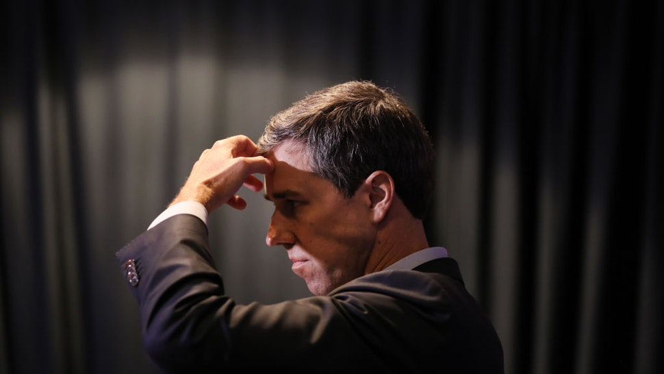 Beto O'Rourke listens to a question from the media at the SEIU Unions for All Summit
